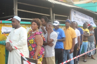 Liberian Voters At Rally Town Market jpg