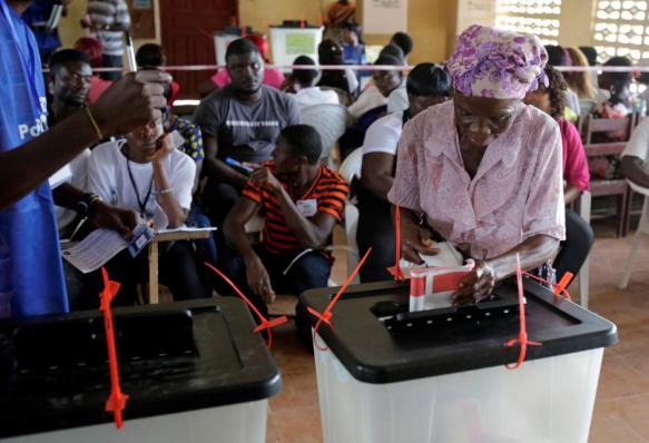 A woman casts her ballot during presidential elections at a polling station in Monrovia