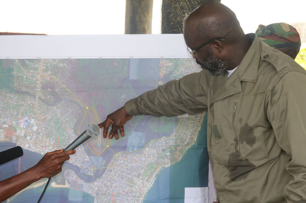 President Weah indicates the Actual Location of Bali Island on the Map of Monrovia