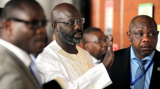 Liberia President George Weah and Finance and Planning Minister Samuel Tweah - Courtesy FrontpageAfricaonline