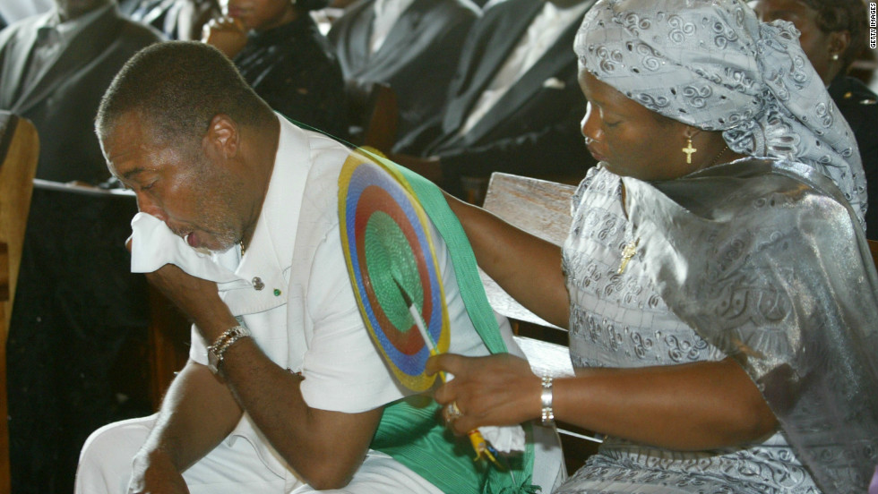Charles Taylor At Funeral of His Mother Comforted By Ex Wife Jewel Howard Taylor - File